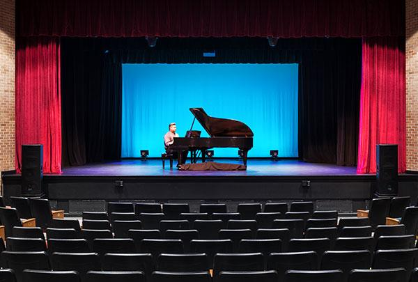 Edson Auditorium stage and grand piano